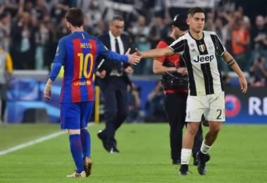 Lionel Messi y Paulo Dybala, futbolistas argentinos del Barcelona y la Juventus.