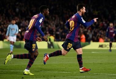 Lionel Messi y Ousmane Dembele. AFP