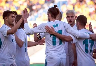 Gareth Bale celebra con sus compañeros del Real Madrid.|AFP
